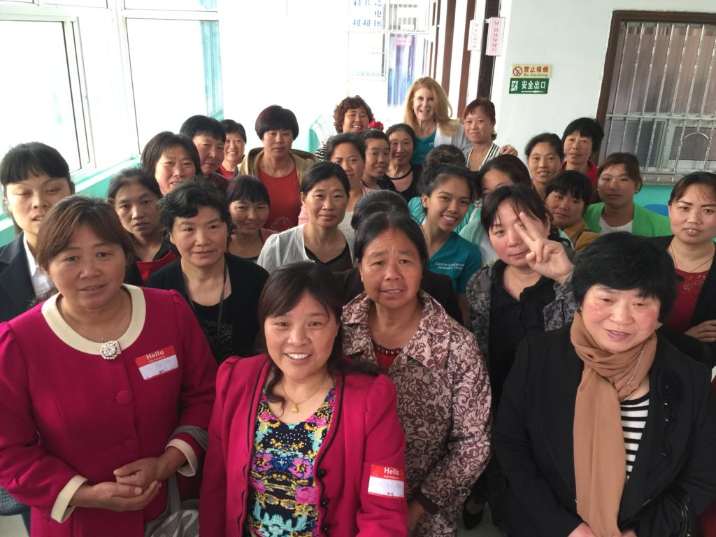 Dr. Patricia Gordon standing with newly trained health professionals in China in  2015.