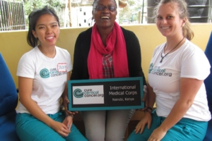 CCC's Kimberly Borden and Jacquelyn Dang with International Medical Corps Rosemary Kombo.